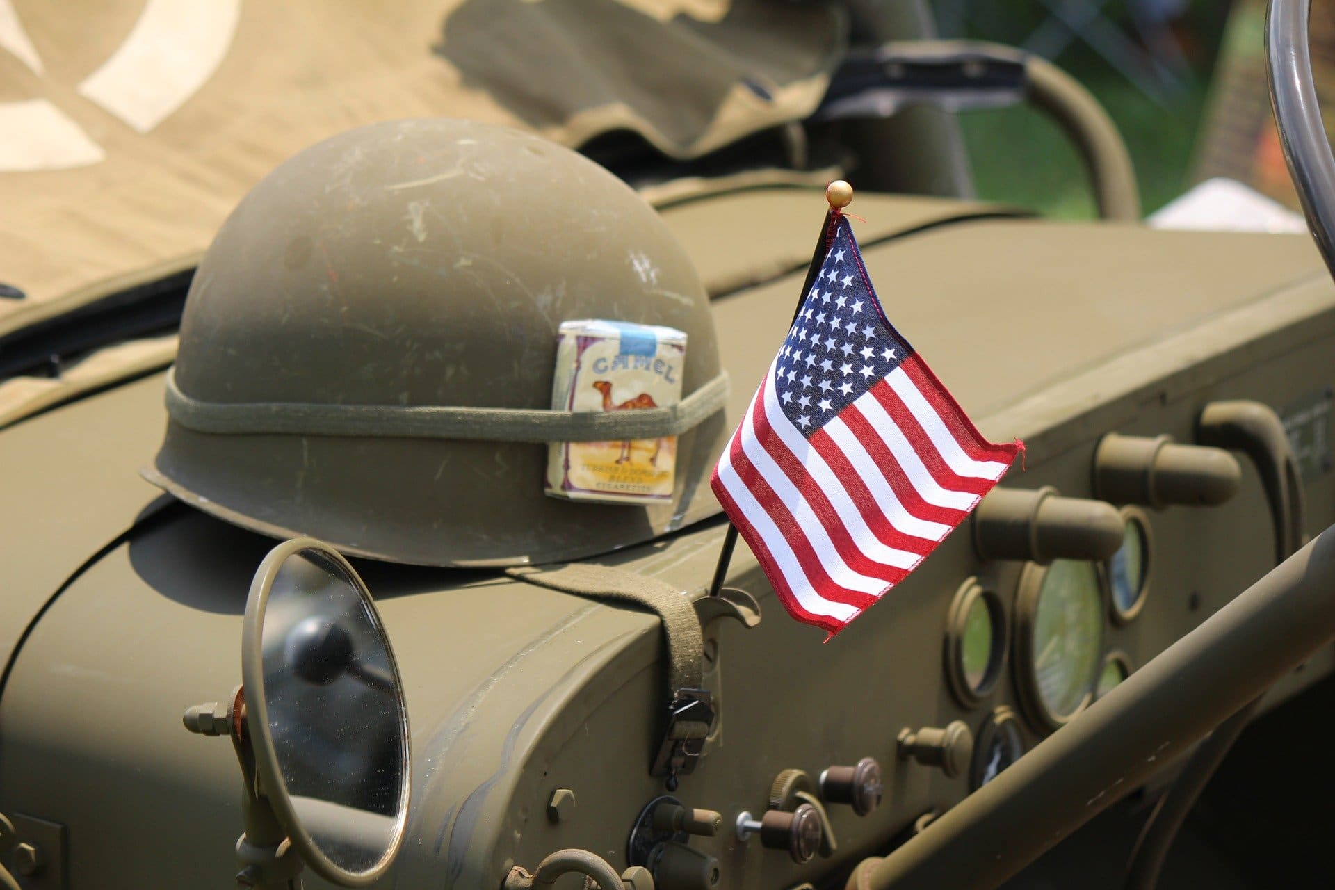 image of the helmet and old army vehicle