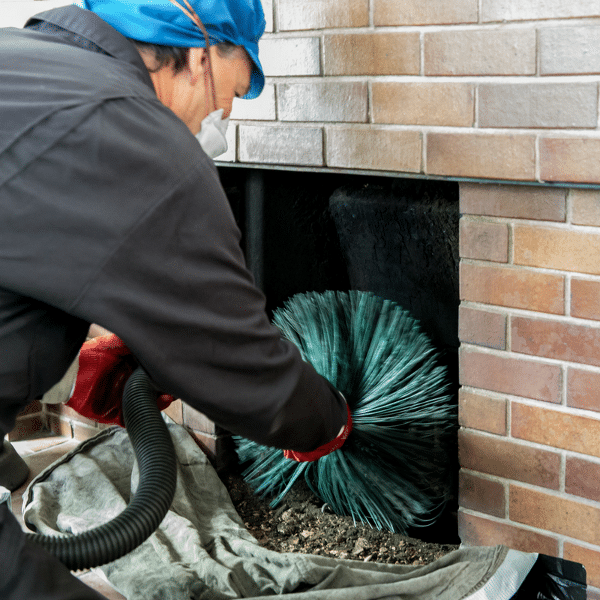 image of man cleaning the chimney